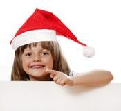 Petite fille heureuse avec le chapeau de Santa Image stock