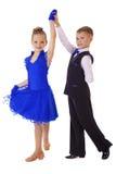 Petite fille heureuse dans la robe bleue de danse Photographie stock
