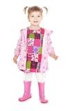 Petite fille heureuse dans les gaines roses au-dessus du blanc Photos stock