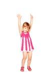 Petite fille heureuse dans une danse tricotée de robe Photo libre de droits
