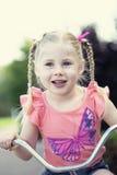 Petite fille heureuse sur le vélo Photographie stock libre de droits