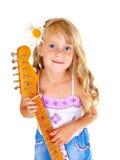 Petite fille jouant la guitare Photos stock