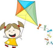 Petite fille jouant le cerf-volant Photos stock