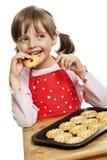 Petite fille mangeant des biscuits photos libres de droits