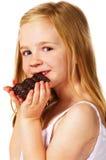 Petite fille mangeant du chocolat Image libre de droits