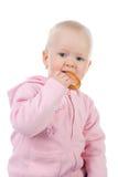 Petite fille mangeant le bagel Images libres de droits