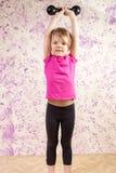 Petite fille mignonne avec la cloche de décharge photographie stock