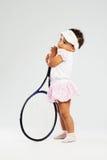 Petite fille mignonne avec la raquette de tennis Image libre de droits