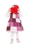 Petite fille mignonne avec le rouge entendu Images libres de droits