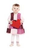 Petite fille mignonne avec le rouge entendu Image stock