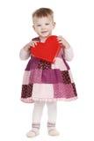 Petite fille mignonne avec le rouge entendu Image libre de droits