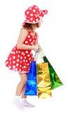 Petite fille mignonne avec un cadeau Images stock