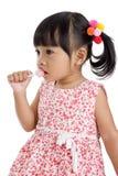 Petite fille mignonne avec une lucette Image libre de droits