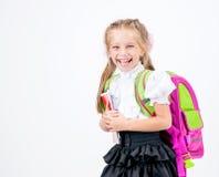 Petite fille mignonne dans l'uniforme scolaire image stock