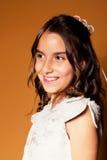 Petite fille mignonne dans son premier jour de communion Photographie stock libre de droits