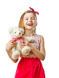 Petite fille mignonne de sourire avec le jouet dans des ses mains Photos libres de droits