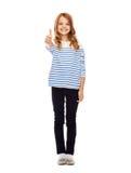 Petite fille mignonne montrant des pouces  Photos libres de droits