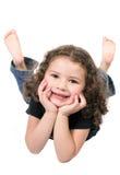 Petite fille mignonne sur l'étage Photographie stock