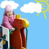 Petite fille mignonne sur le fond bleu Photo libre de droits