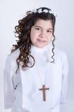 Petite fille posant pour la première communion Photos stock