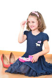 Petite fille posant tout en composant Photographie stock