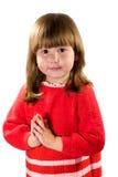 Petite fille priant pour? Photographie stock libre de droits
