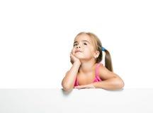 Petite fille rêveuse Photographie stock libre de droits