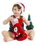 Petite fille recherchant un cadeau de Noël Photo stock