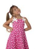 Petite fille regardant vers le haut Photographie stock libre de droits