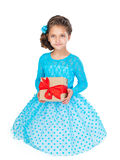 Petite fille retenant un cadeau Photos stock