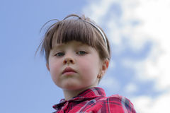 Petite fille sérieuse Image stock