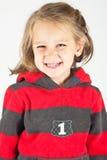 Petite fille souriant à l'appareil-photo Images stock