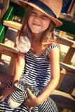 Petite fille sur la cour de jeu Images stock
