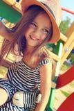 Petite fille sur la cour de jeu Photos stock