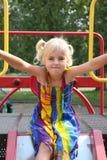 Petite fille sur la glissière Photos libres de droits