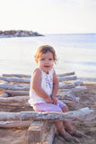 Petite fille sur la plage Photographie stock