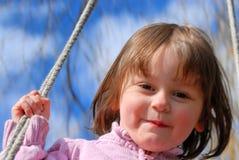 Petite fille sur une oscillation Photos libres de droits