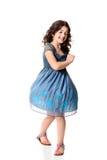 Petite fille tournant avec la robe bleue Images stock