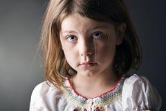 Petite fille triste Photographie stock libre de droits