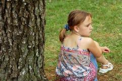Petite fille triste, boudant Photo libre de droits
