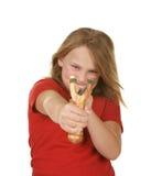 Petite fille vilaine avec une fronde Photo stock