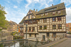 Petite France area in Strasbourg, France. Picturesque historic half-timbered buildings on the canal bank in Petite France area in Strasbourg, France in summer Stock Photo