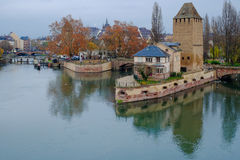 Petite France in evening, Strasbourg, France. Petite France and Ponts Couverts upon Ill river in gloomy weather, Strasbourg, Alsace, France royalty free stock photo