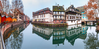 Petite France in the morning, Strasbourg, Alsace. Panorama of traditional Alsatian half-timbered houses with mirror reflections in Petite France in the morning Stock Photo