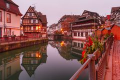 Petite France in the morning, Strasbourg, Alsace. Traditional Alsatian half-timbered houses in Petite France with mirror reflections in the morning, Strasbourg Stock Images
