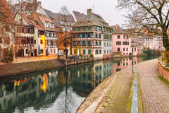 Petite France in the morning, Strasbourg, Alsace. Traditional Alsatian half-timbered houses with mirror reflections in Petite France in the morning, Strasbourg Royalty Free Stock Images