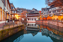 Petite France in the morning, Strasbourg, Alsace. Traditional Alsatian half-timbered houses in Petite France with mirror reflections during morning blue hour Royalty Free Stock Photos