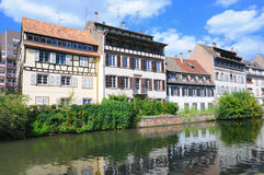 Petite France in Strasbourg. View from river of tourist area Petite France in Strasbourg, France with reflections in water Royalty Free Stock Photo