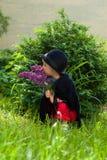 Petite girl on nature. In bush Stock Photos