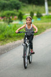 Petite girl rides a mountain bike. Sport. Stock Image